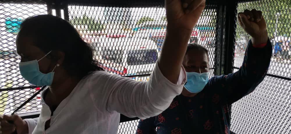 Saras and Jody inside a police van, post-arrest, 2 June 2020 in Ipoh.