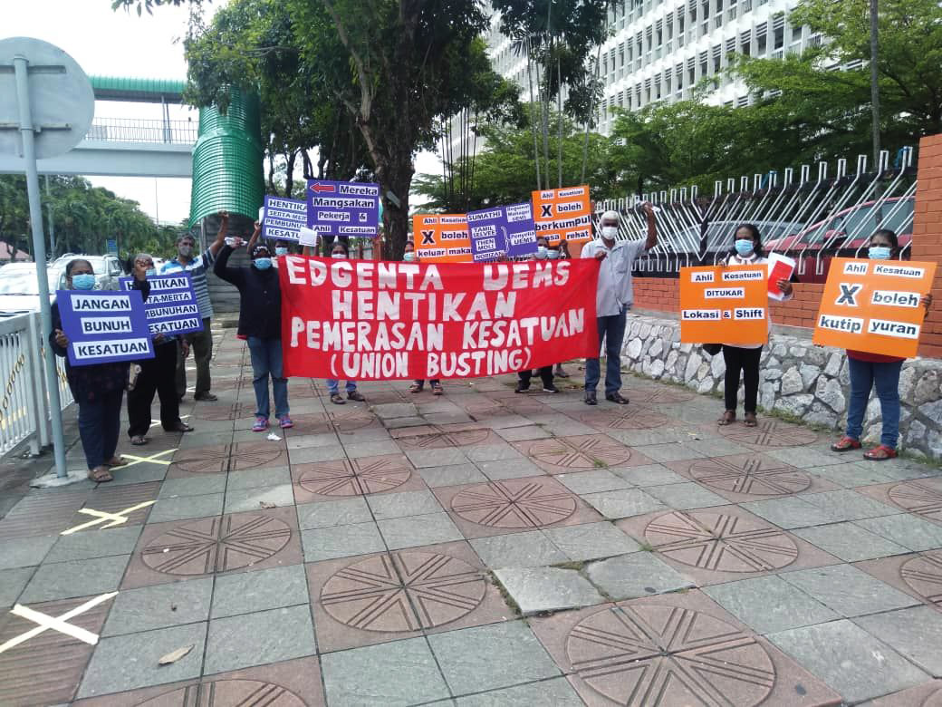 "NUWHSAS protestors outside Hospital Ipoh, 2 June 2020. The centre banner translates to ""EDGENTA UEMS STOPS UNION-BUSTING""."