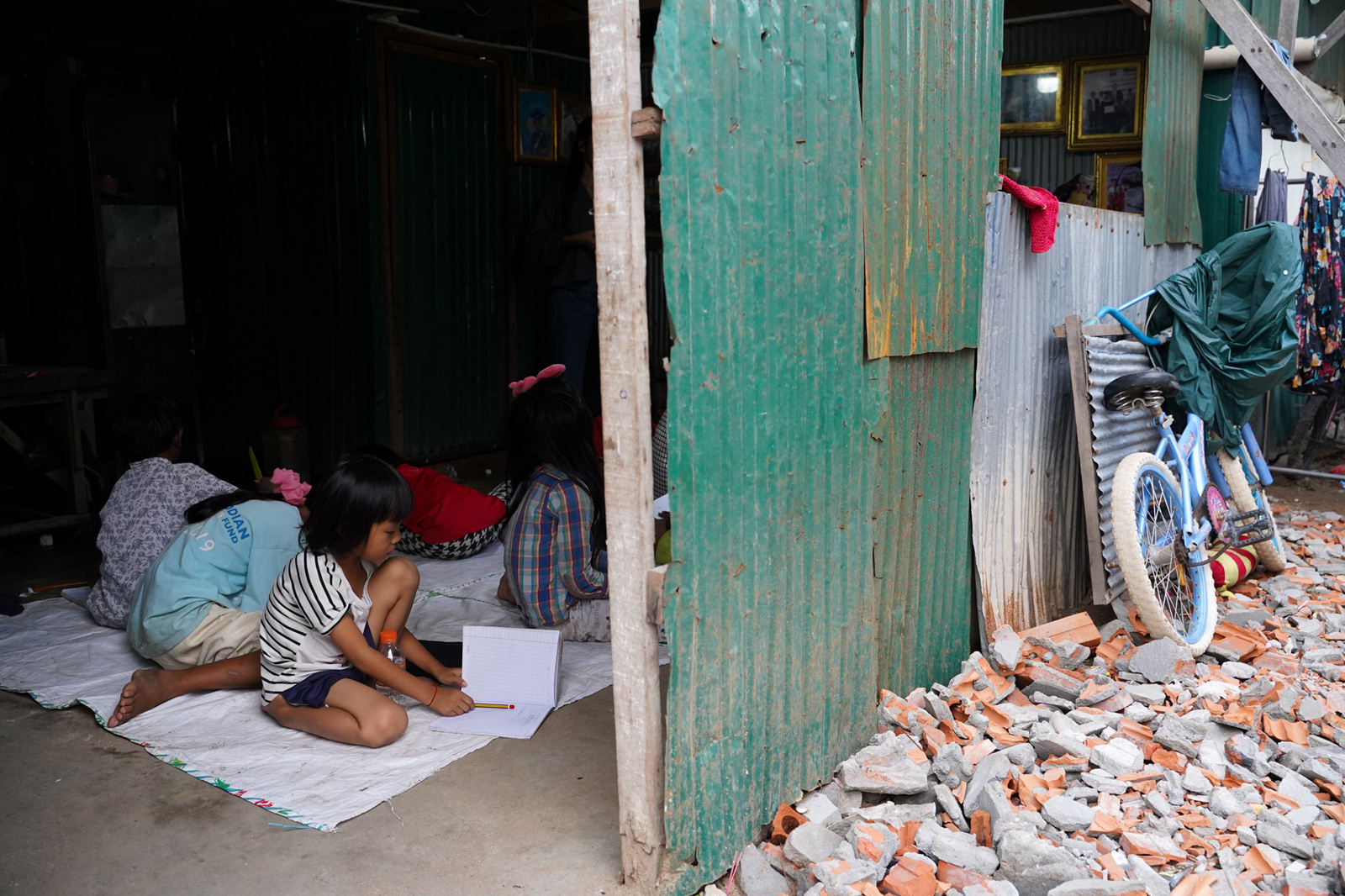 Children in Phnom Penh's Stung Meanchey District study under neighbours' homes while some schools remain closed due to the coronavirus pandemic.