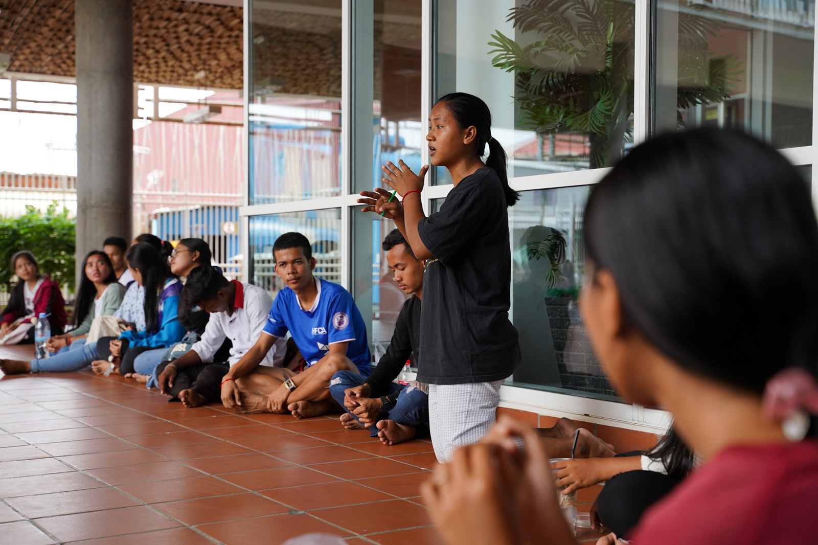 Sreymai speaks during a meeting with other youth leaders in her community to discuss upcoming community service initiatives.