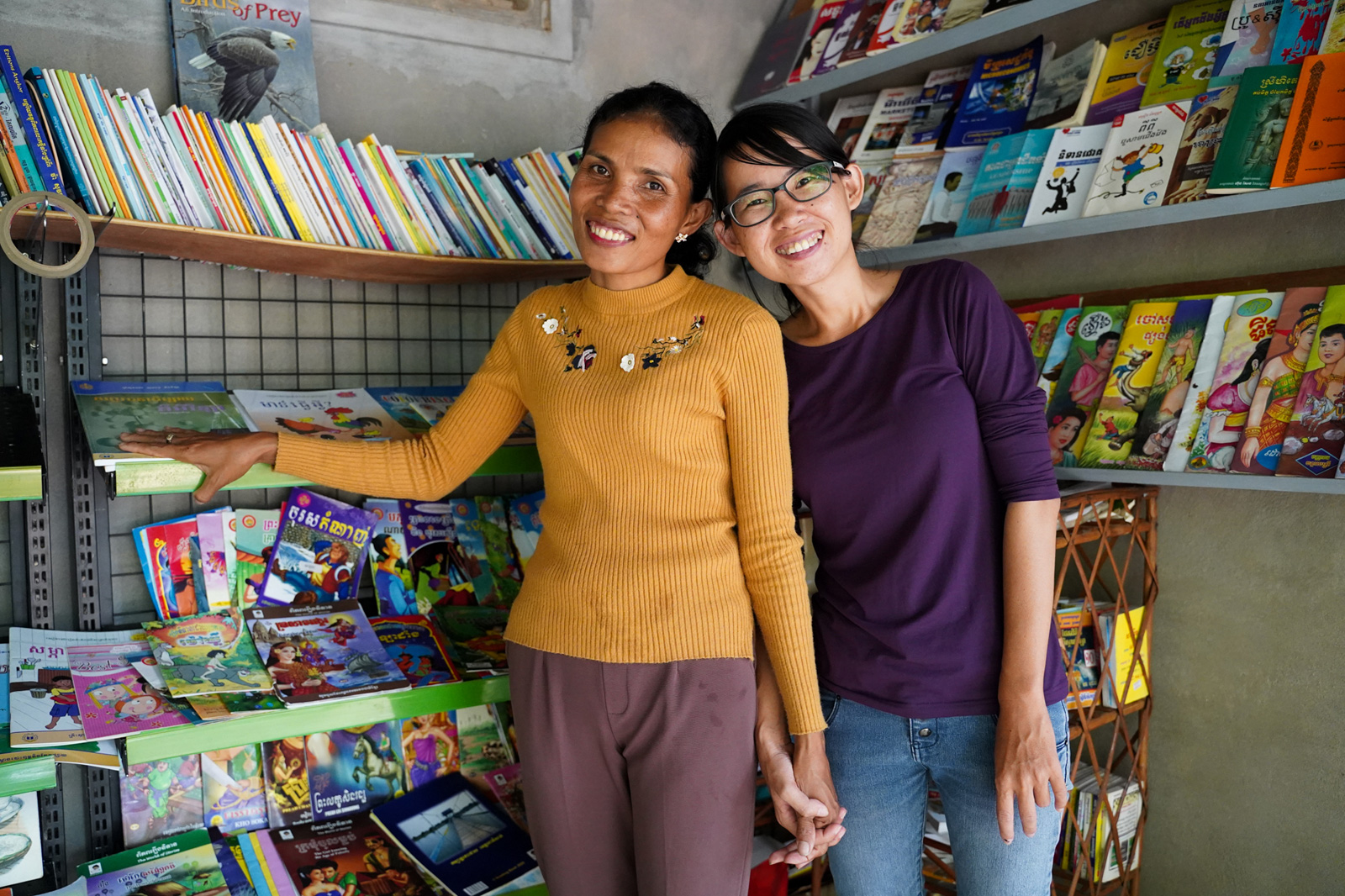 """Soth Bopha (right), 29, knew Khat Da (left), 41, was the right person to choose as a librarian for the first Village Library in Areak Svay Village. """"She does things from the heart, not for money,"""" Bopha says, referring to Da."""