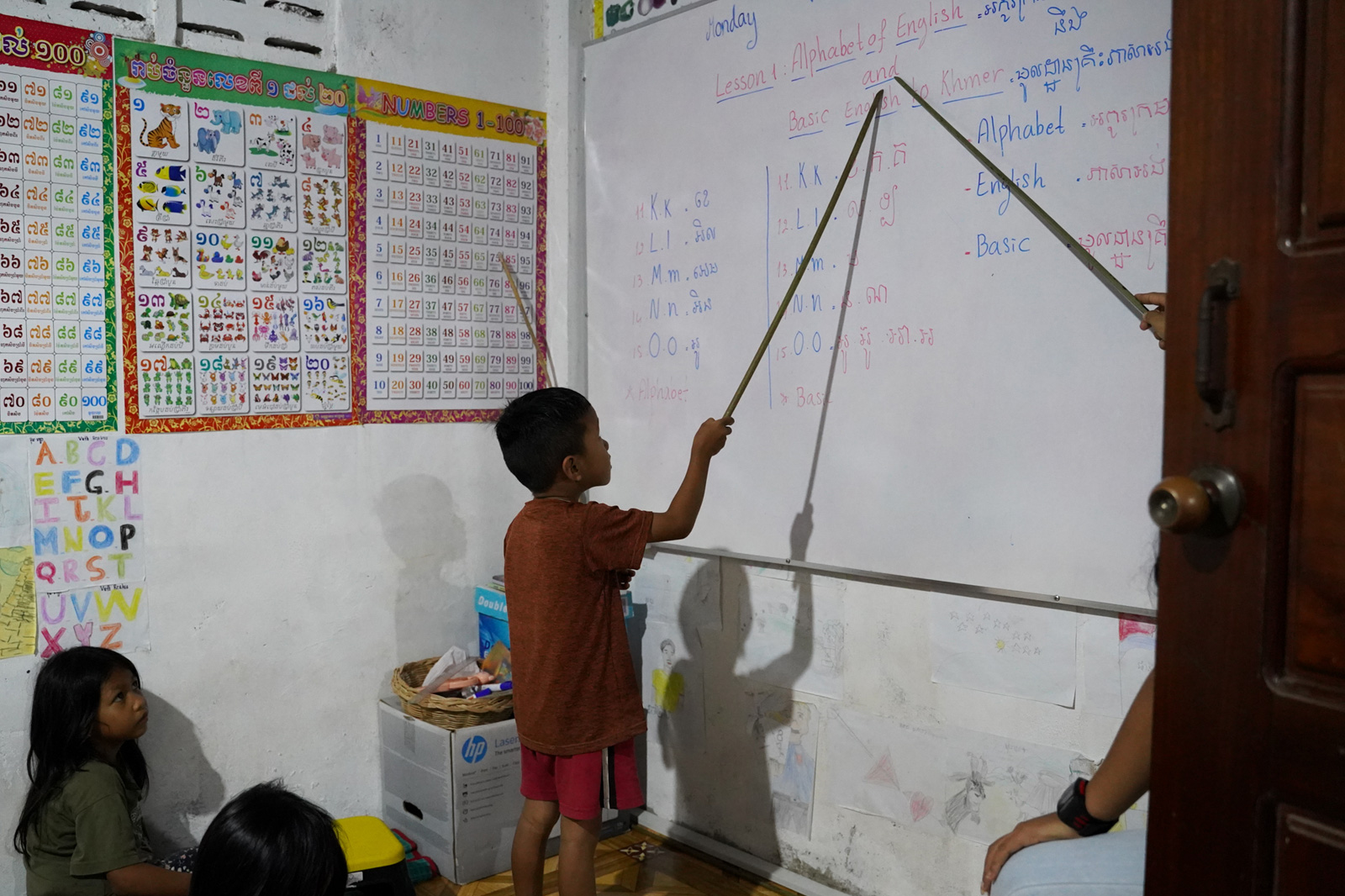 Students are divided into different English classes according to their level at the Village Library in Roha Village.
