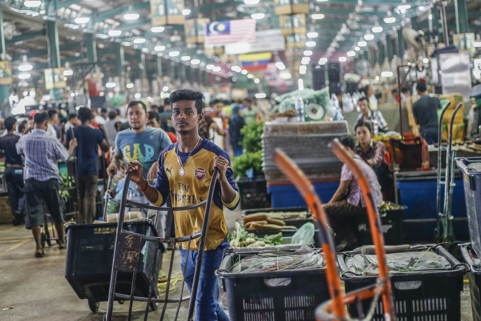 Foreign workers from Bangladesh and Myanmar work at a wholesale market in Kuala Lumpur in 2016.