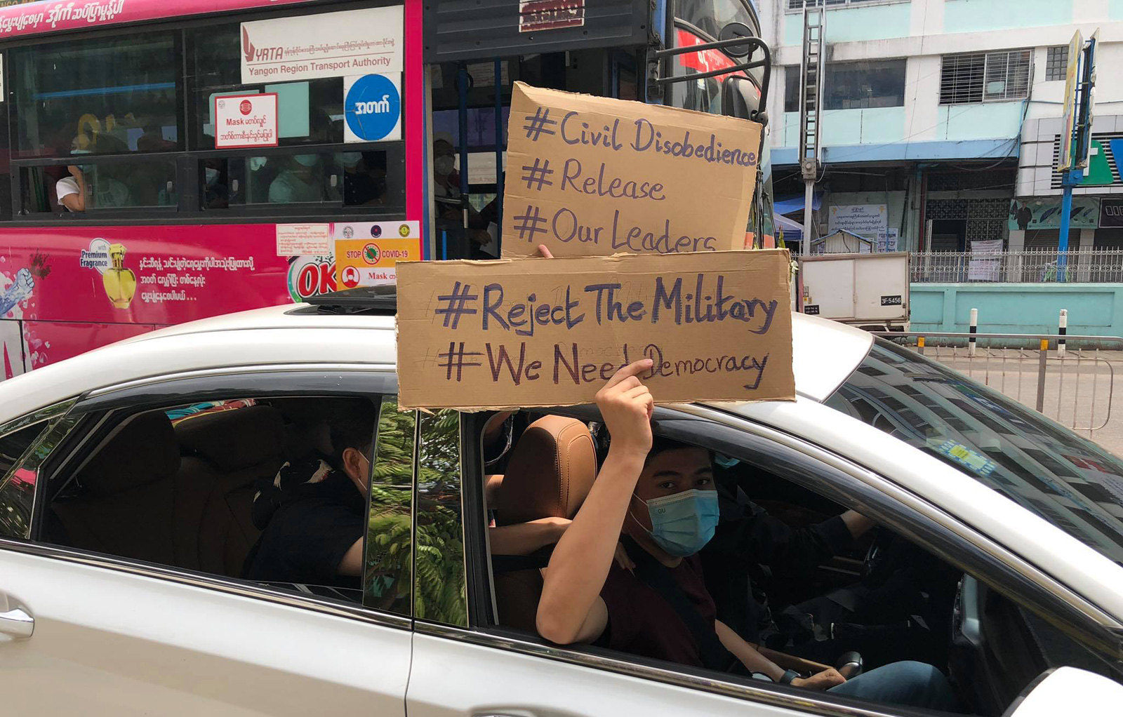 Protesters in Yangon hold signs denouncing Myanmar's military coup in February 2021.